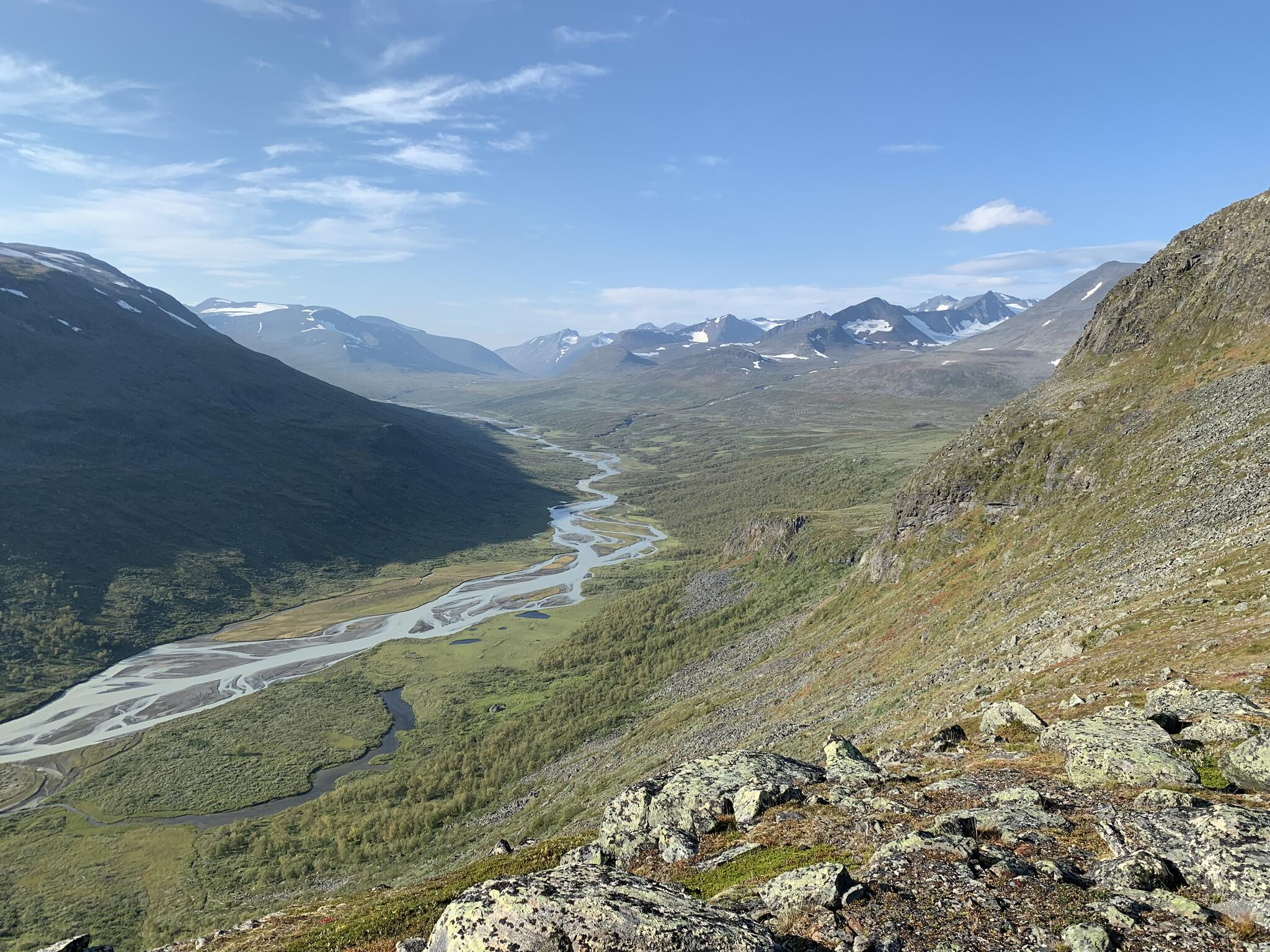 The upper Rapadalen and Skarja seen from Snavvavagge.  The path passes just below the cliff on the right.